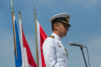 CDR Anthony Burrows of the Royal Australian Navy gives a reading at the 2016 Los Angeles ANZAC Day service on board the USS Iowa